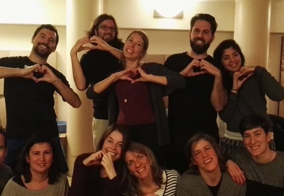 workshop group that make heart symbol with hands